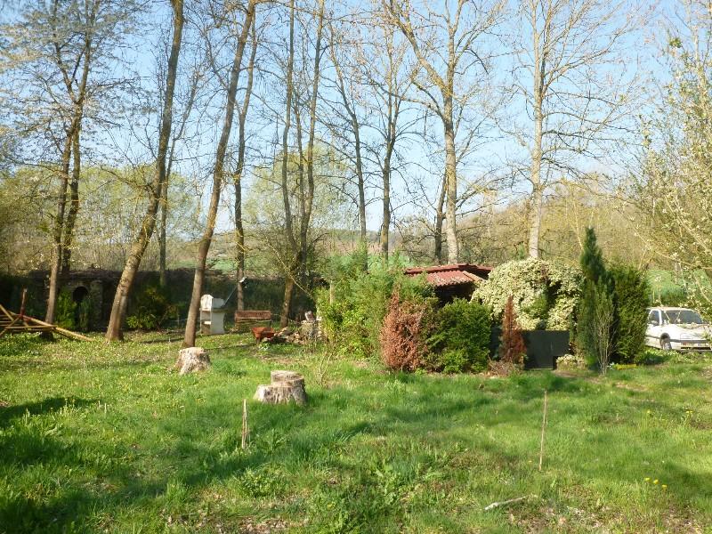 Erlon immobilier : Espace détente avec terrasse couverte