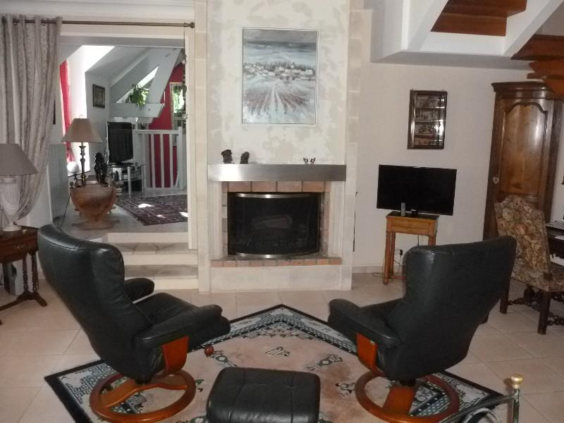 Erlon immobilier : Séjour double avec cheminée